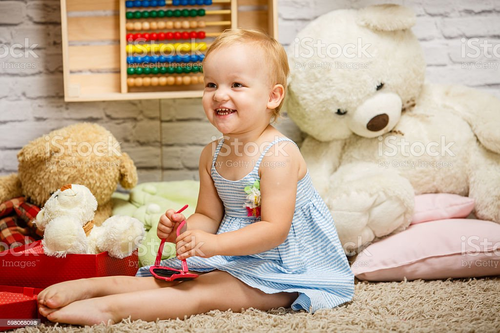 Little girl playing in her room stock photo