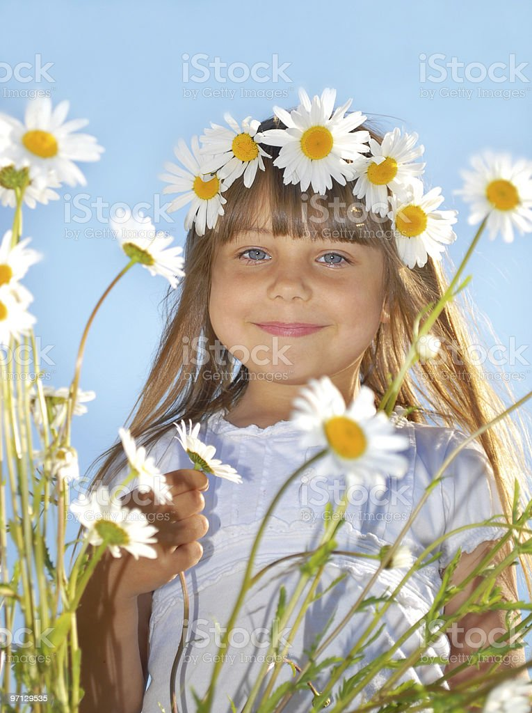 little girl playing in marguerite field royalty-free stock photo