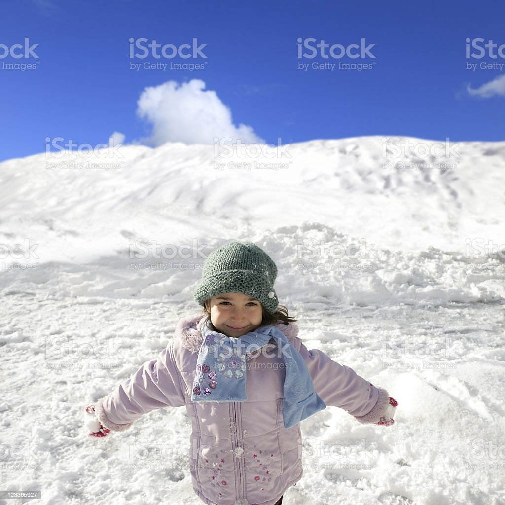 little girl playing in snow royalty-free stock photo