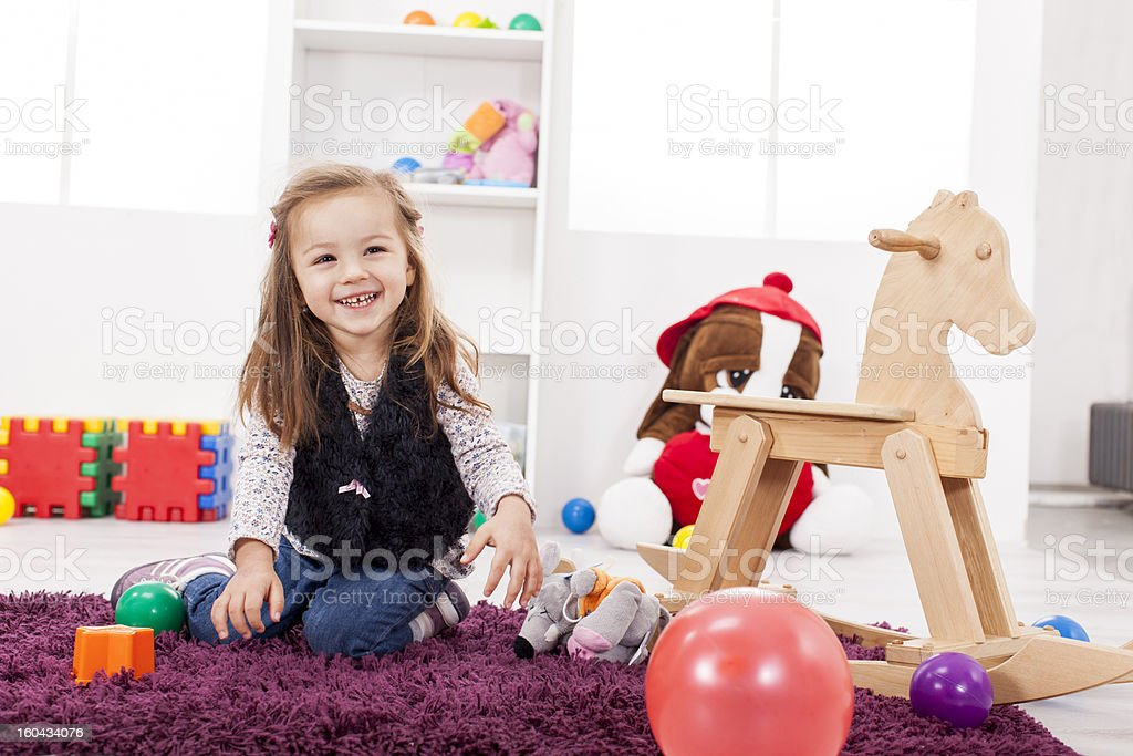 Little girl playing in the room royalty-free stock photo
