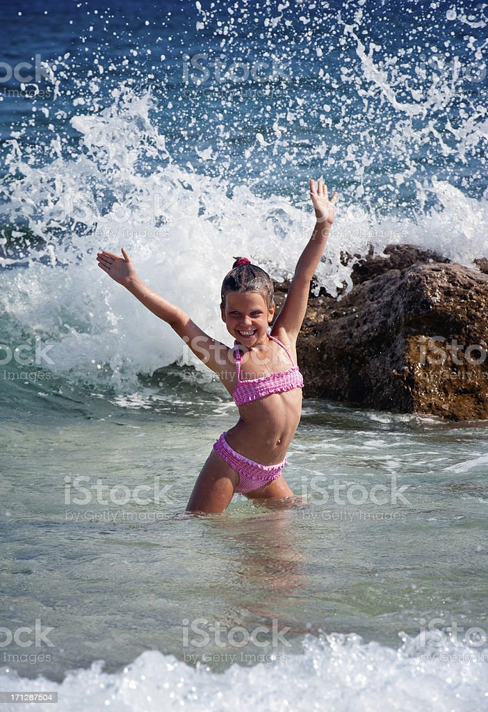 Little girl playing in the sea stock photo