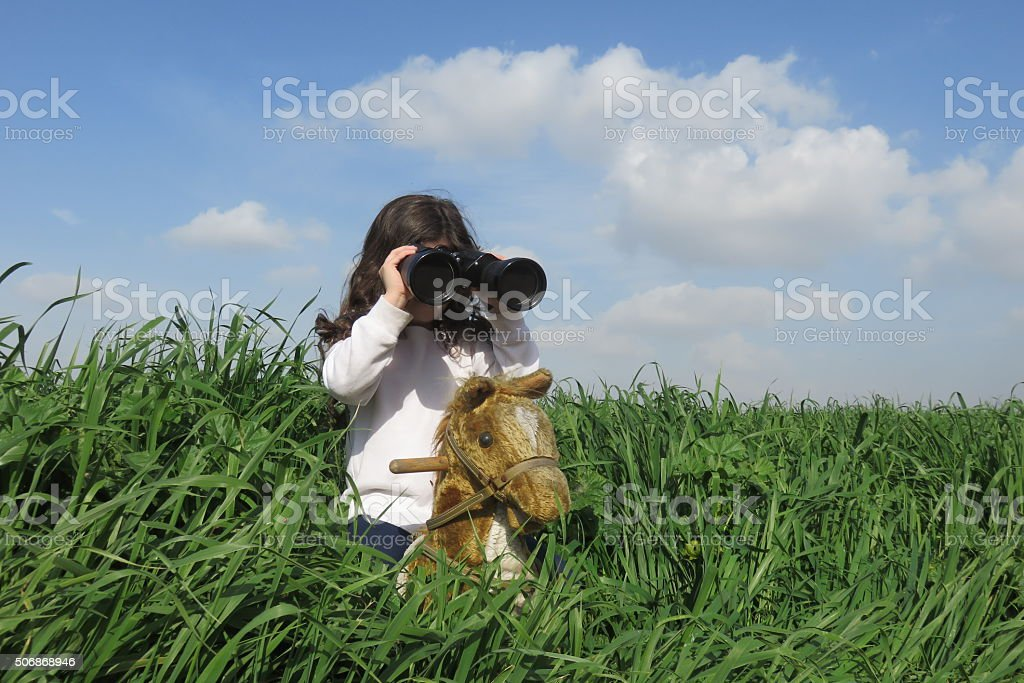little girl playing make-believe stock photo