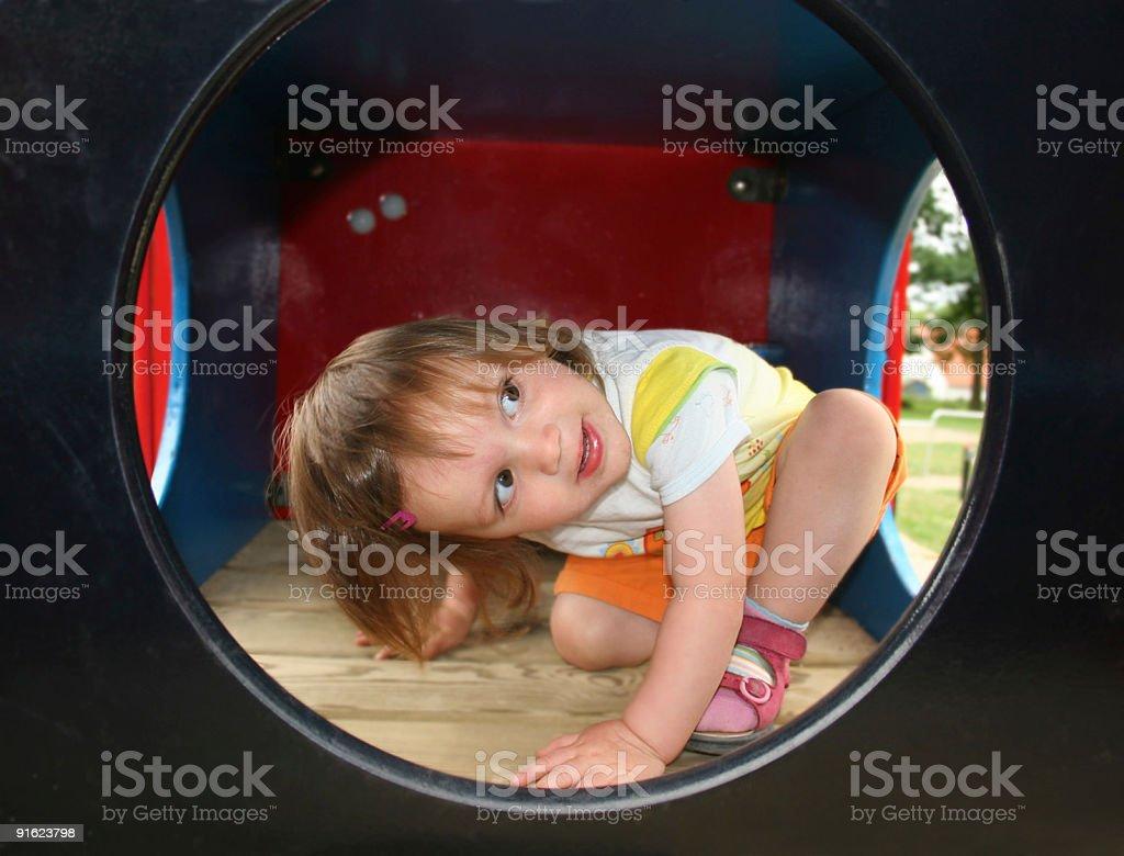 Little girl playing on a children's playground / Mädchen auf Kinderspielplatz royalty-free stock photo