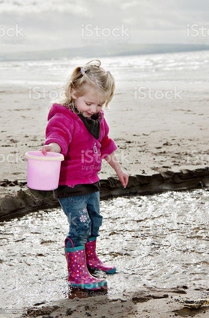 little girl playing on beach royalty-free stock photo