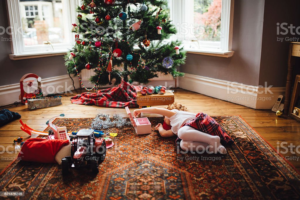 Little Girl Playing on Christmas Day stock photo