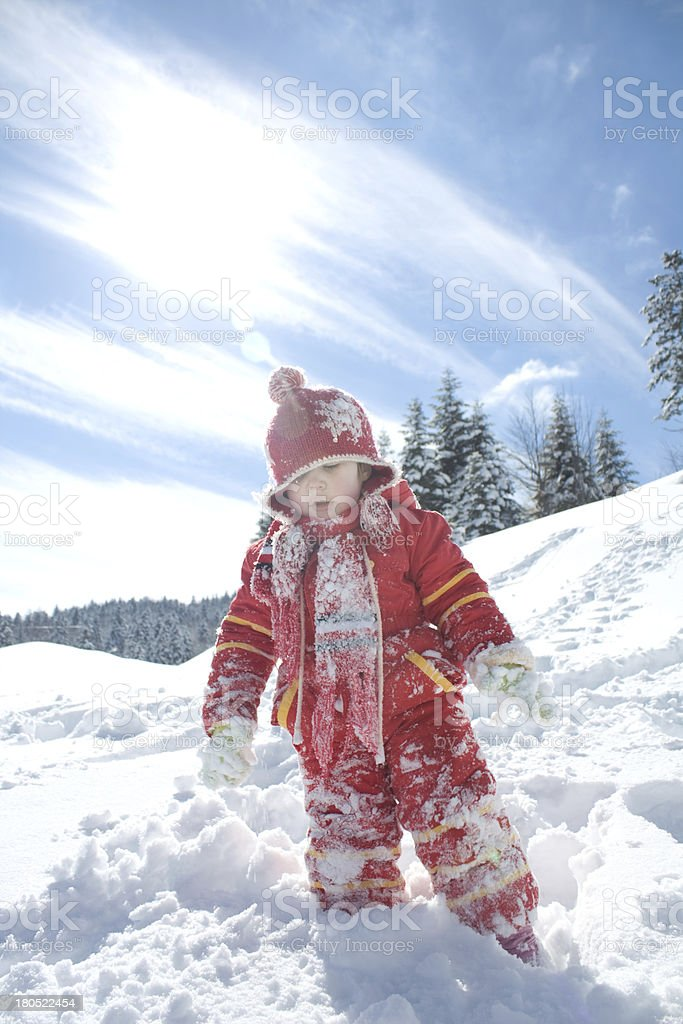 little girl playing on the snow royalty-free stock photo