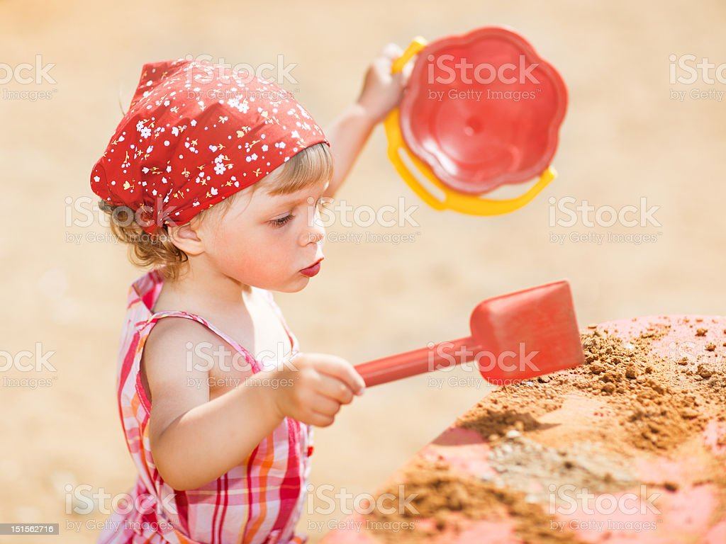 Little girl playing outdoors royalty-free stock photo