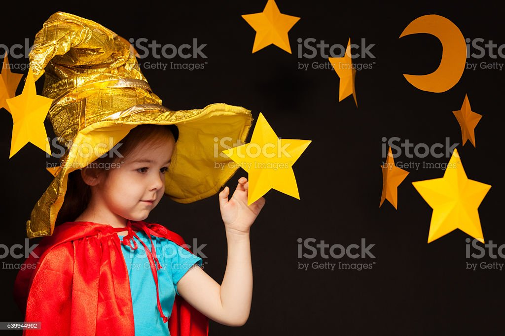 Beautiful five years old girl playing sky watcher with handmade stars...
