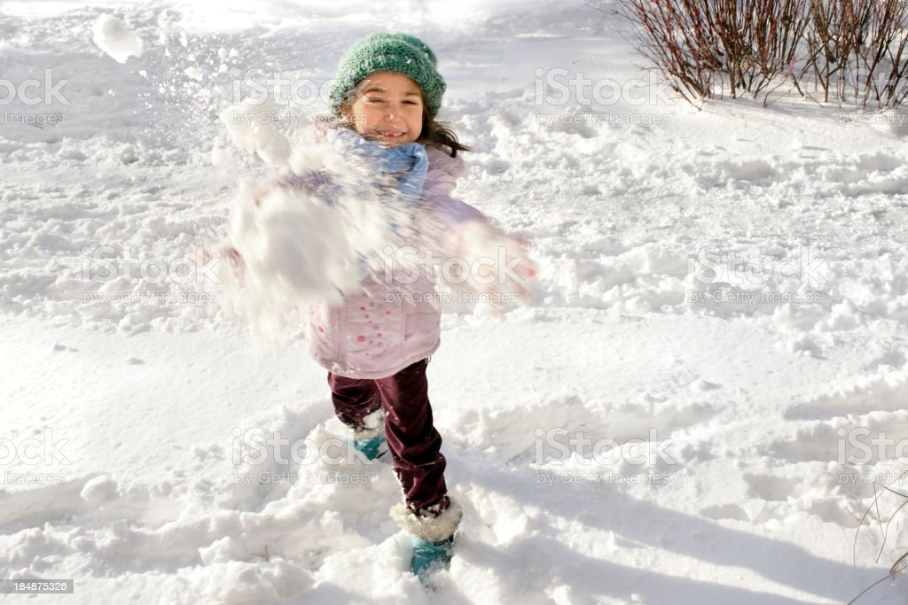 little girl playing snowball stock photo