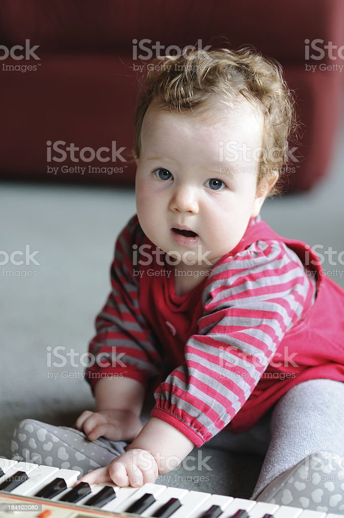 Little girl playing the toy piano royalty-free stock photo