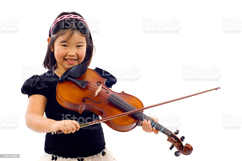 Little girl playing the violin isolated on white background stock photo