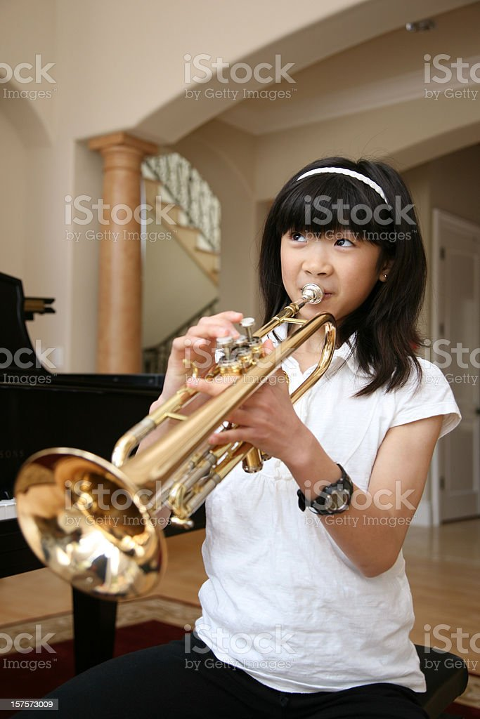 Little Girl Playing Trumpet royalty-free stock photo