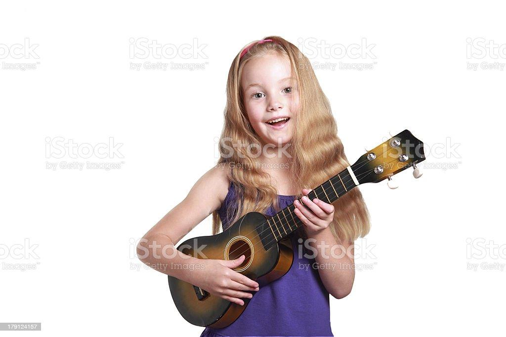 little girl playing ukulele stock photo