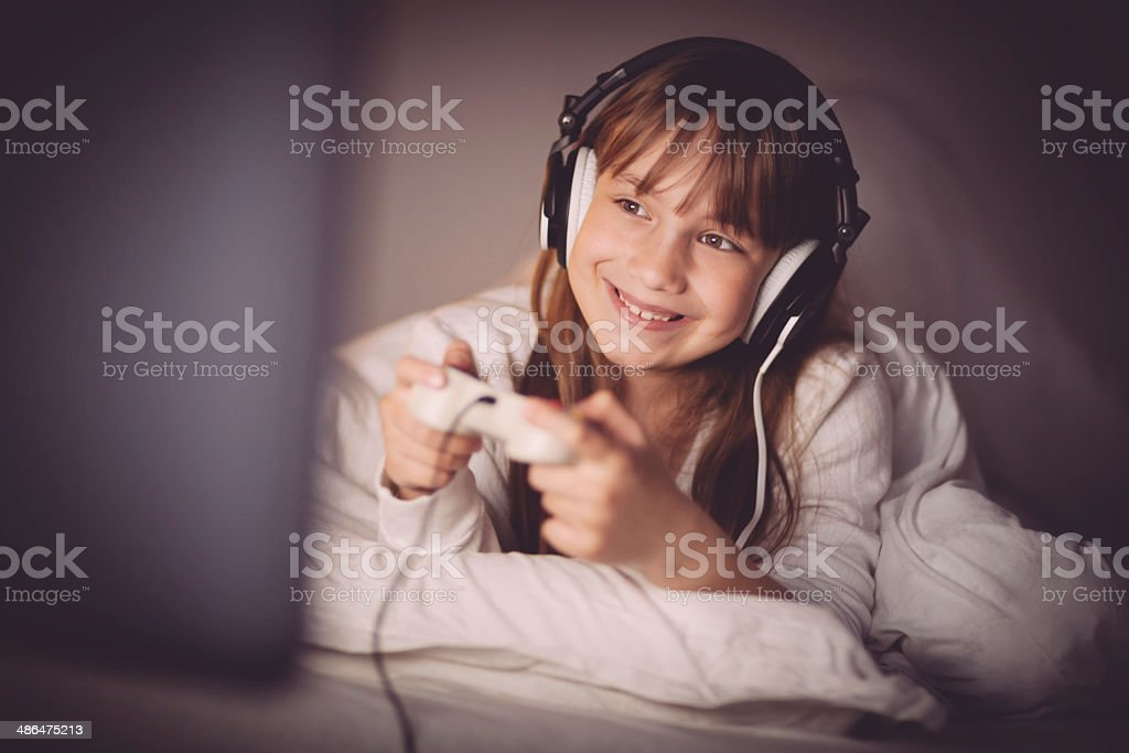 Little girl playing video games royalty-free stock photo