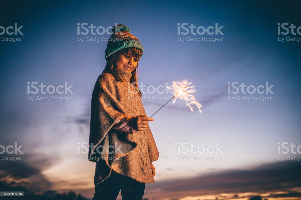 Little Girl Playing With a Sparkler stock photo