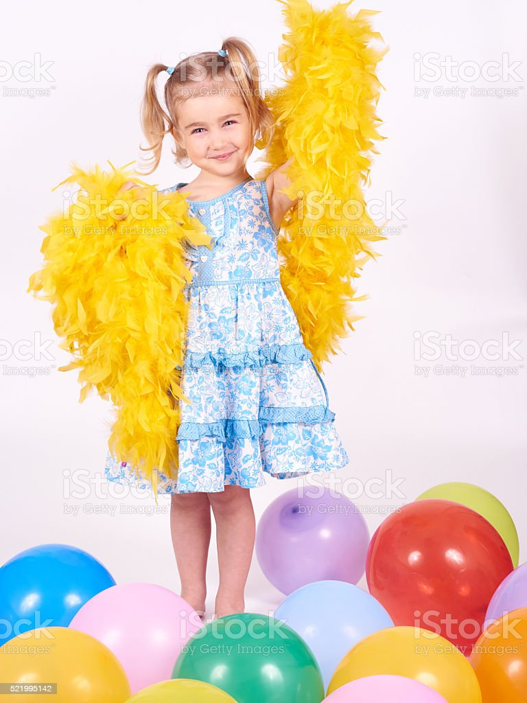 Little girl playing with balloons and boa stock photo