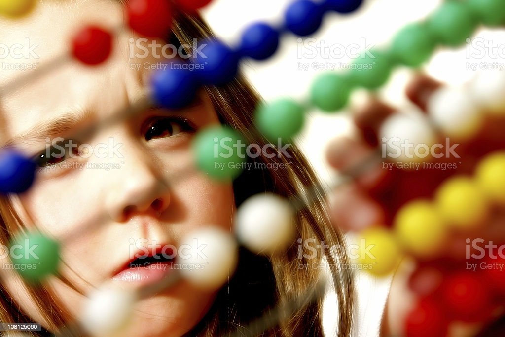 Little Girl Playing with Colorful Abacus Beads royalty-free stock photo