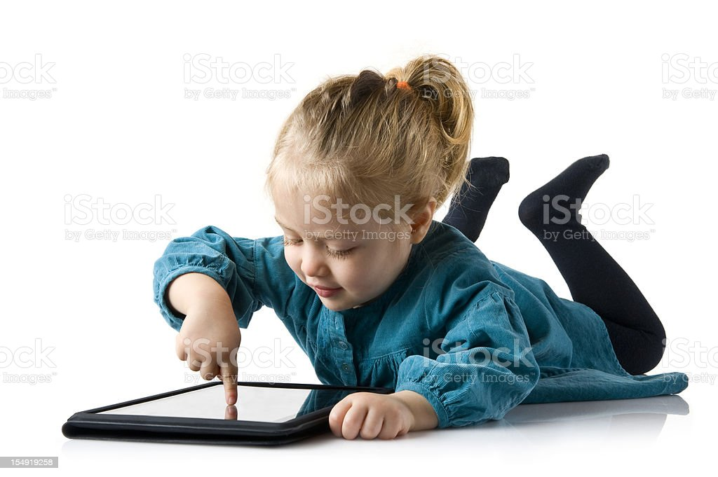 Little Girl Playing With Daddy's Tablet Computer.Color Image royalty-free stock photo