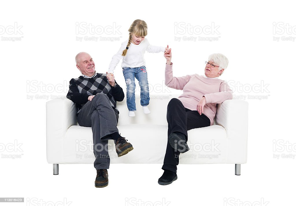 Little girl playing with her grandparents royalty-free stock photo