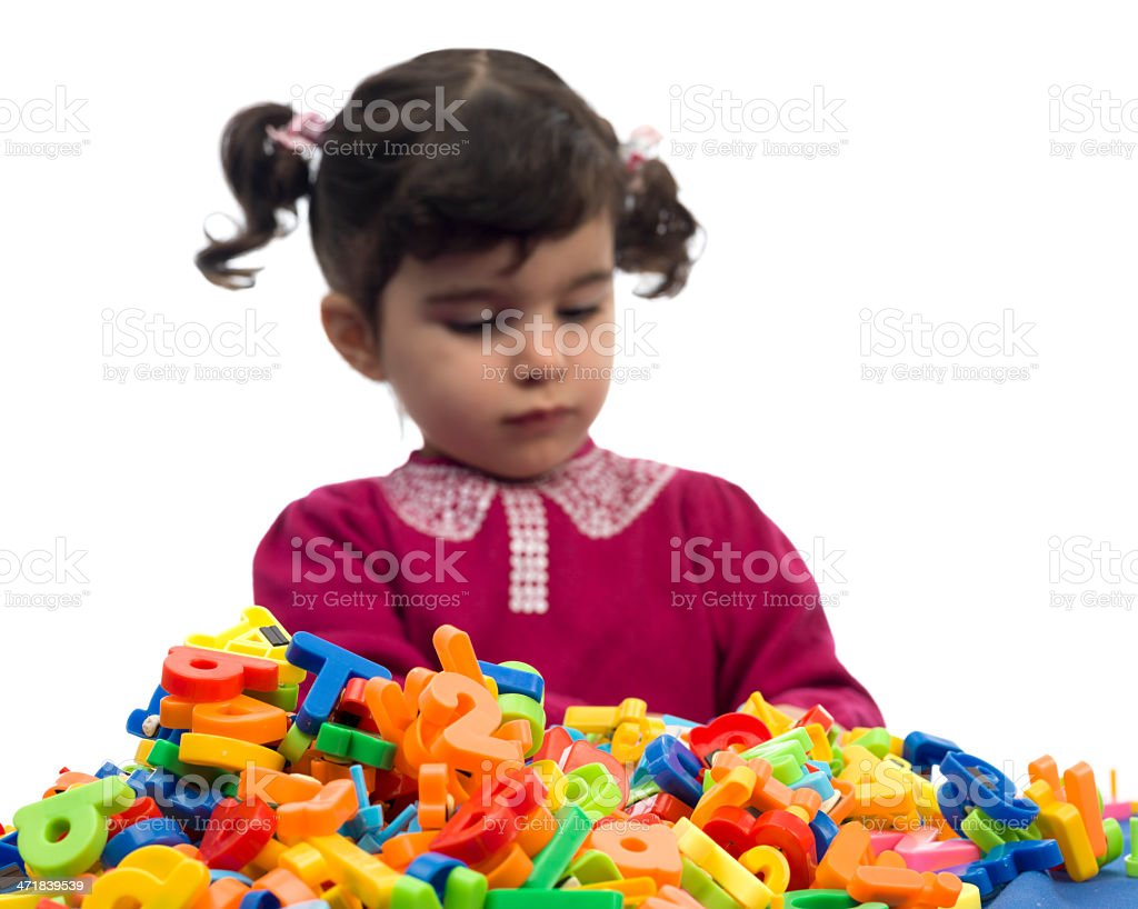 Little girl playing with letters royalty-free stock photo