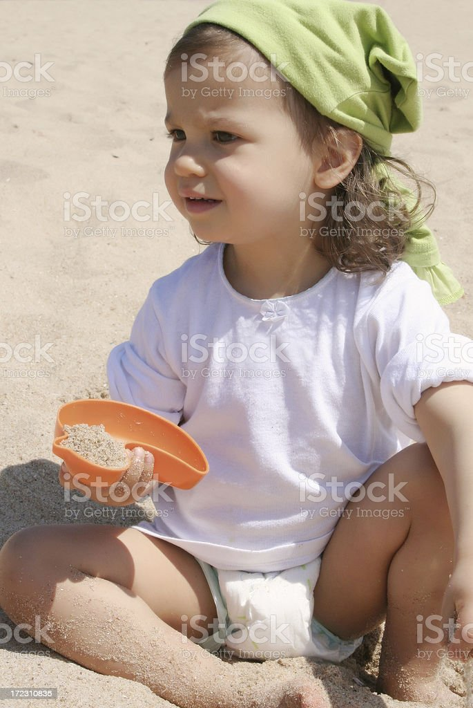 Little girl playing with sand royalty-free stock photo