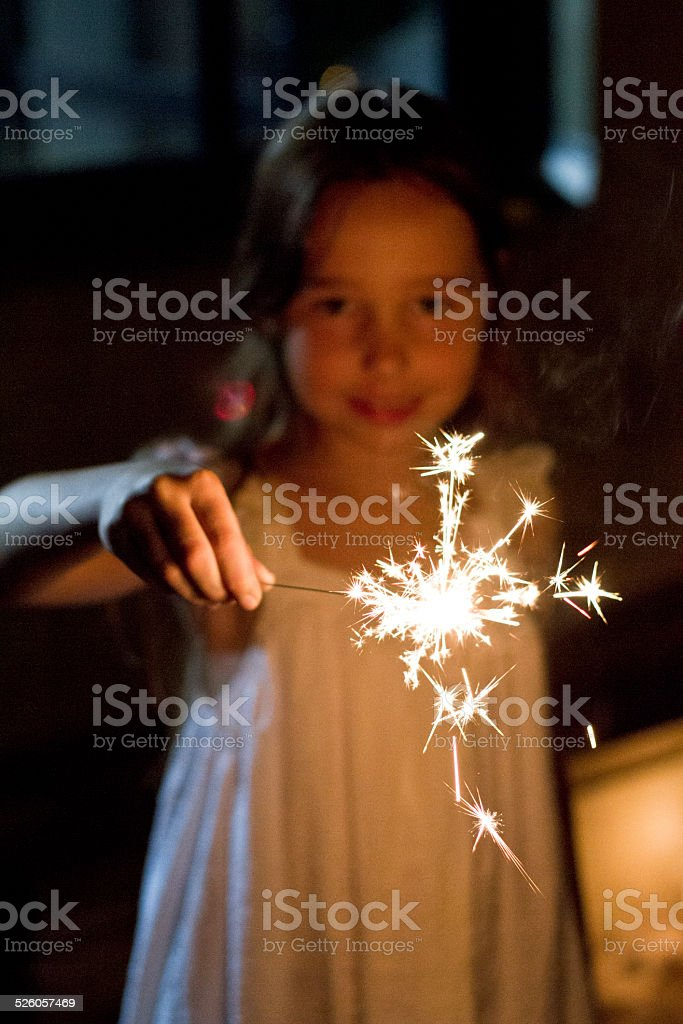 Little girl playing with Sparkler stock photo