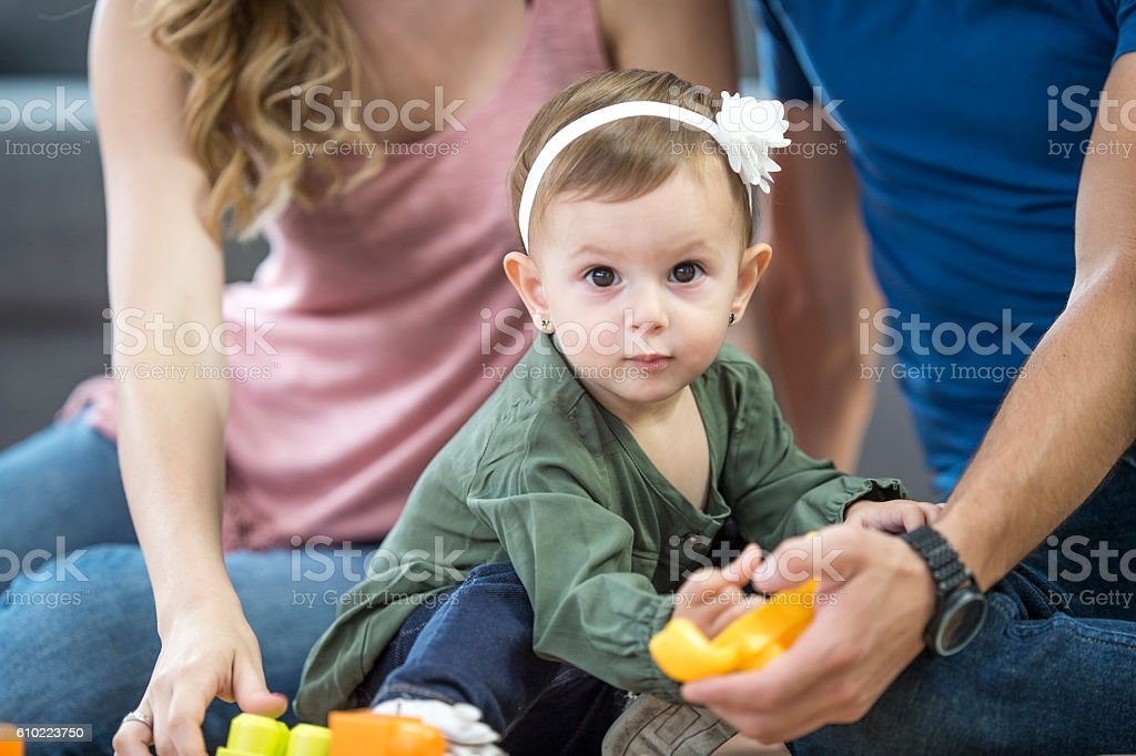 Little Girl Playing with Toys stock photo