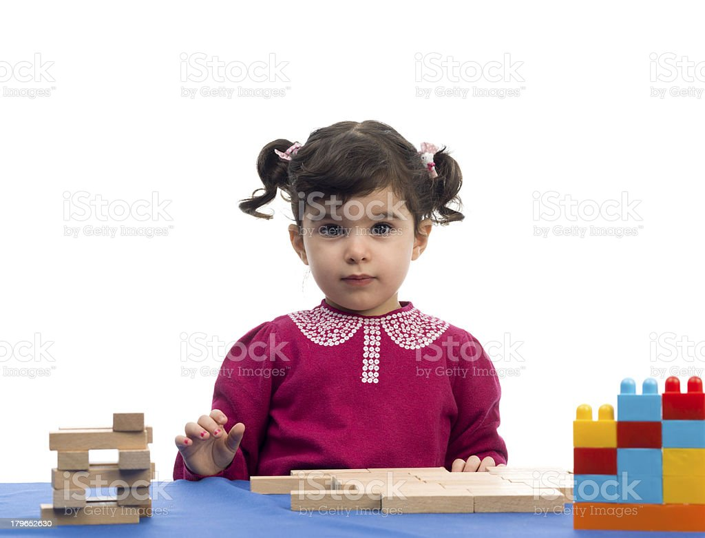 Little Girl Playing With wooden Building Blocks royalty-free stock photo