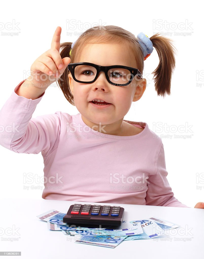 Little girl plays with money royalty-free stock photo