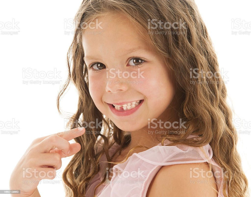 Little Girl Points to First Missing Tooth stock photo