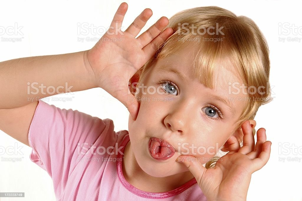 Little Girl Poking Tongues stock photo