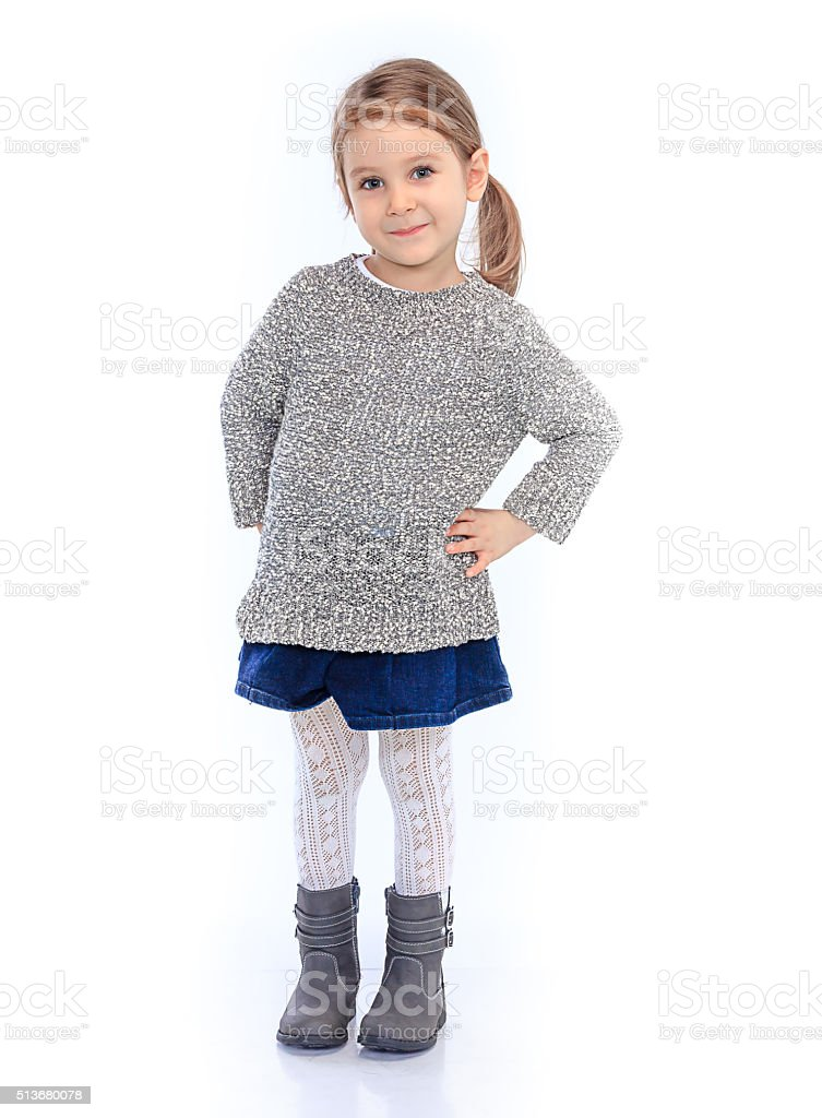 Little girl posing like a model with hands on hips. stock photo