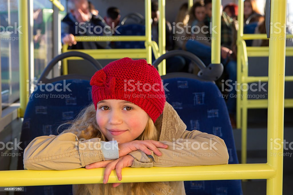 Little girl posing on the bus stock photo