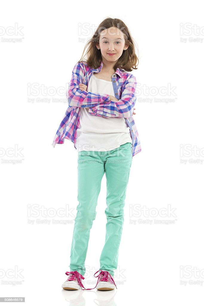 Little girl posing with arms crossed stock photo