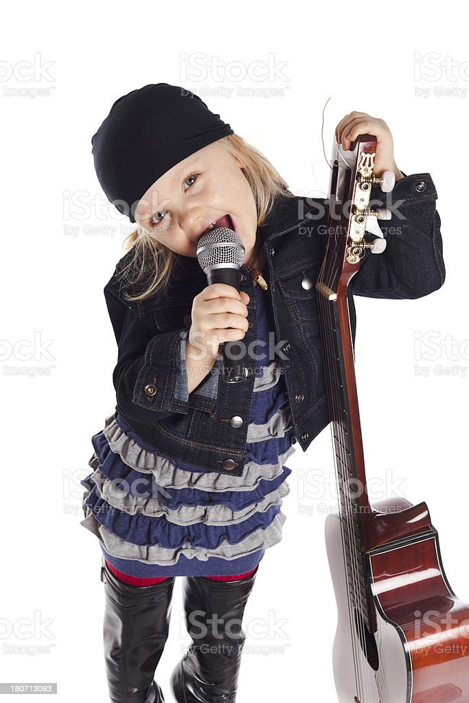Little girl posing with guitar and microphone royalty-free stock photo