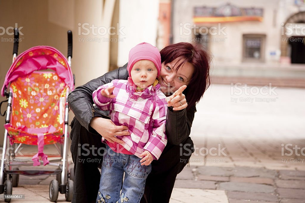 Little girl posing with mom stock photo