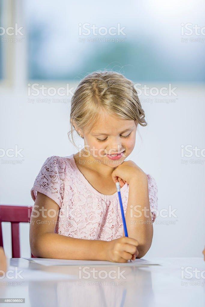 Little Girl Practicing Handwriting stock photo