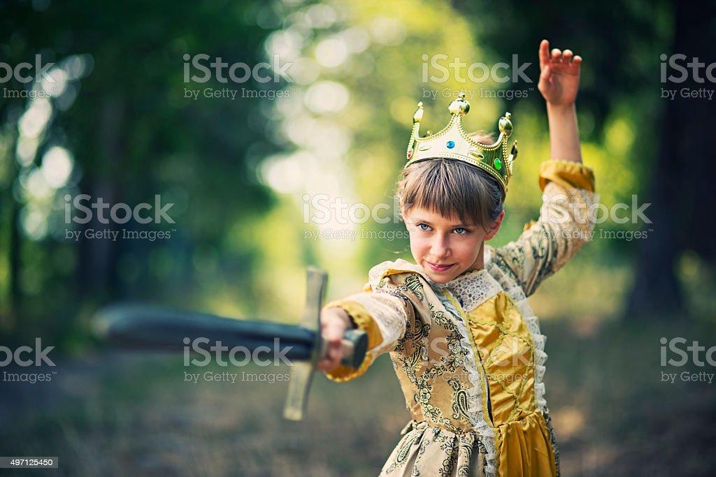 Little girl practicing swordplay - princess that doesnt need saving stock photo