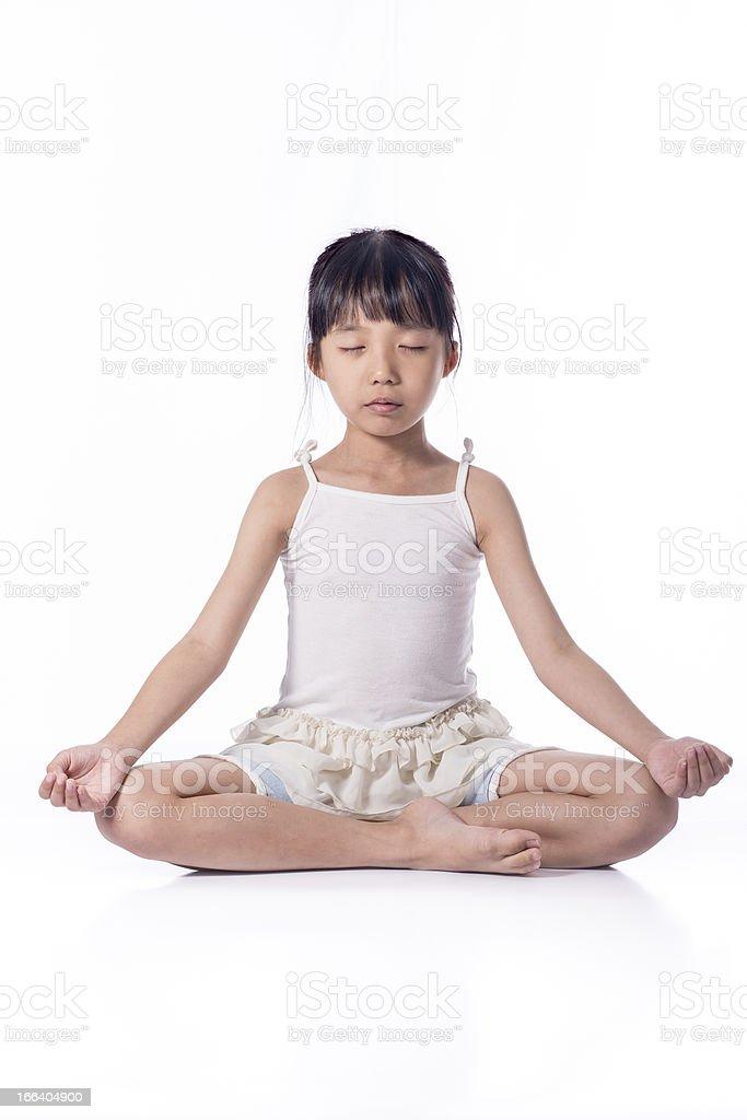 Little girl practicing yoga royalty-free stock photo