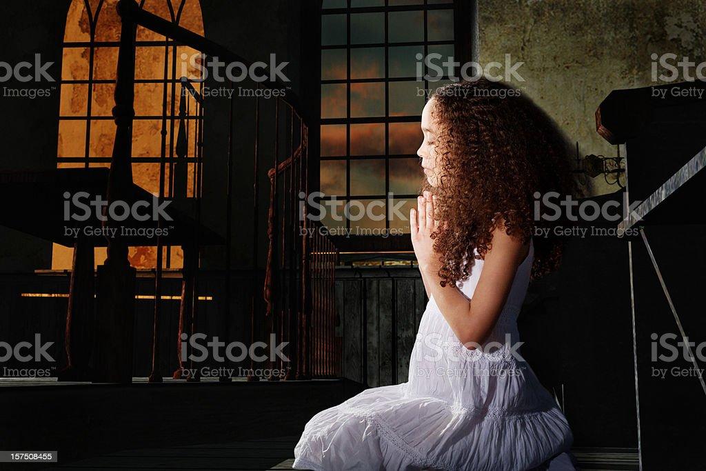 Little girl praying in Church. royalty-free stock photo