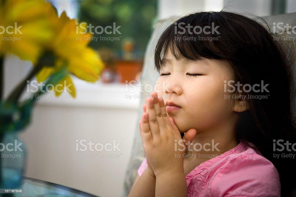 Little girl praying royalty-free stock photo