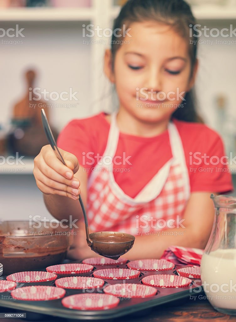 Little Girl Preparing Chocolate Cookies at Home stock photo