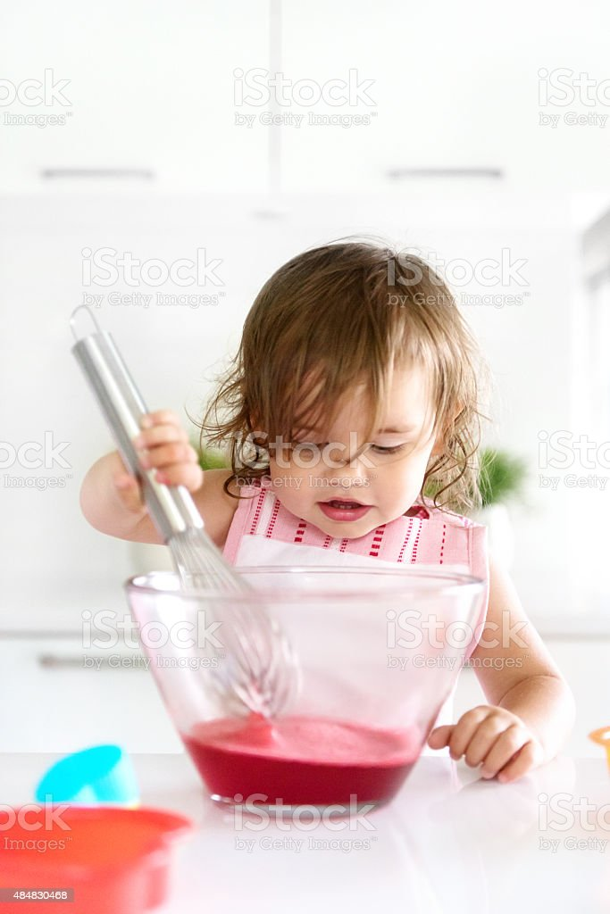 Little girl preparing jello stock photo