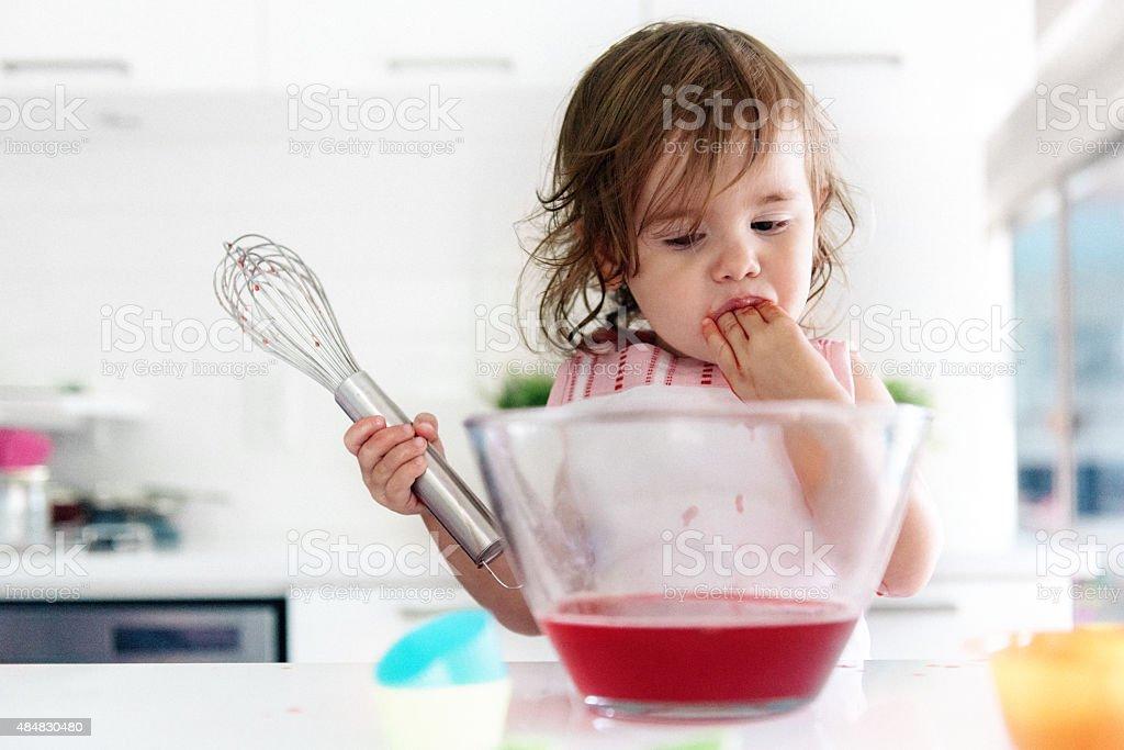 Little girl preparing jello stock photo