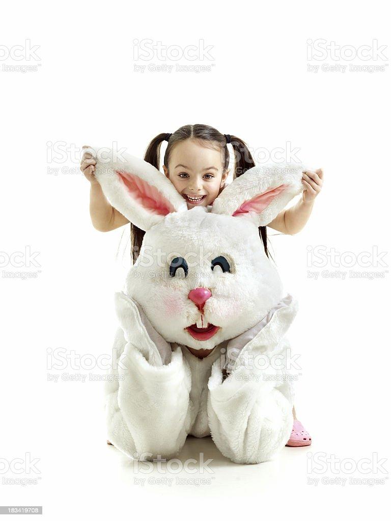 Little girl pulling bunny ears stock photo