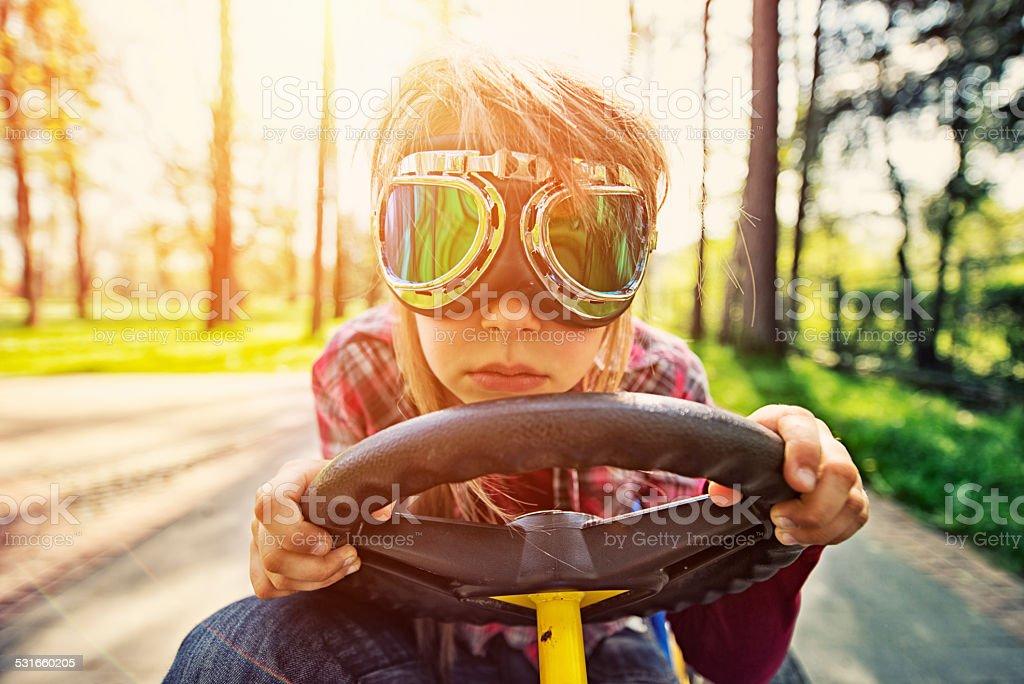 Little girl racing stock photo