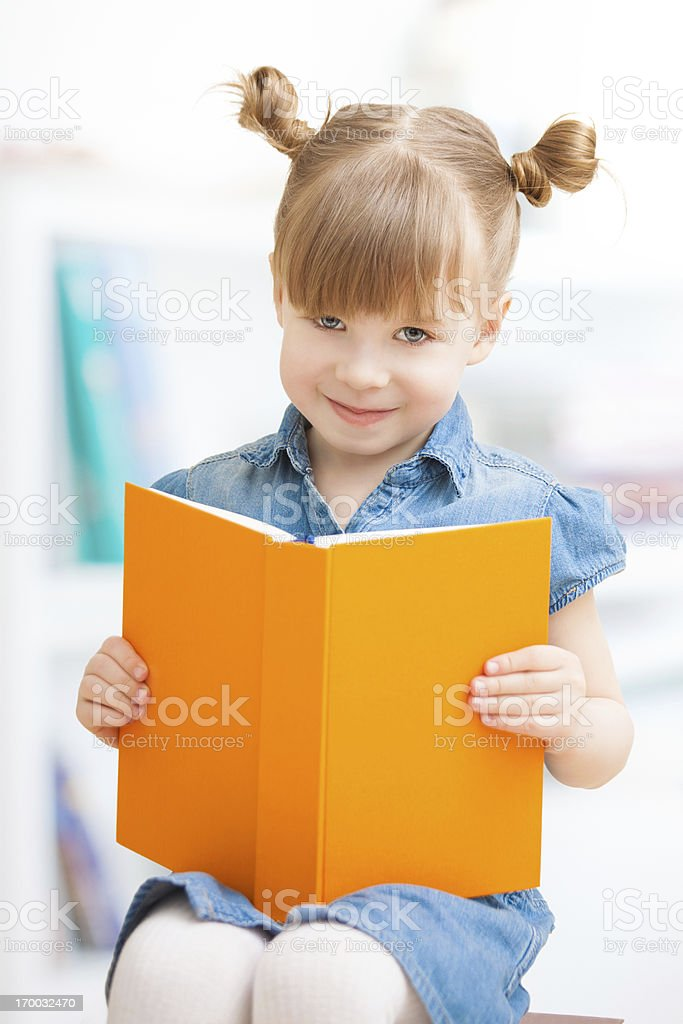 Little girl reading a book royalty-free stock photo