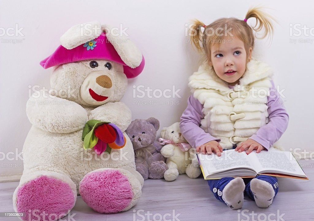 Little girl reading a book. royalty-free stock photo
