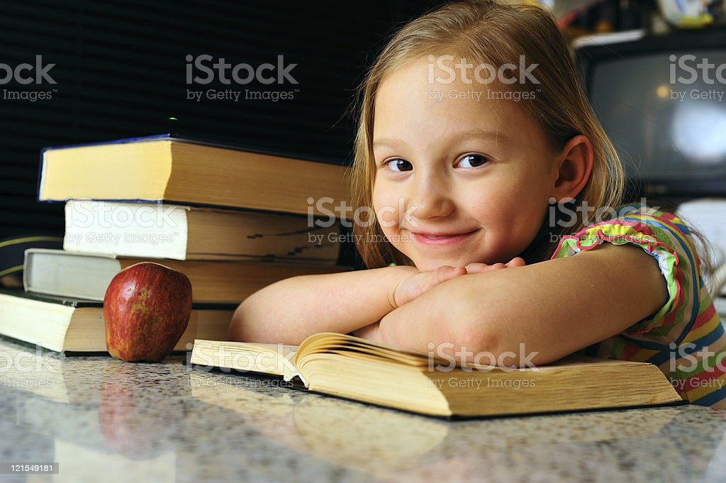 Little girl reading royalty-free stock photo