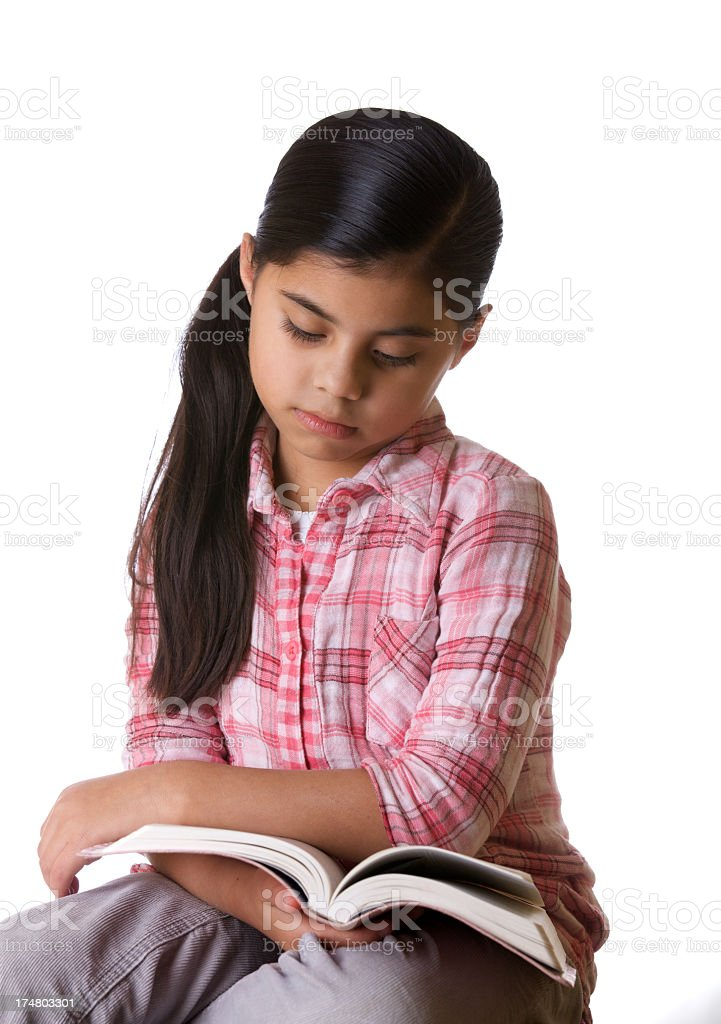 Little girl reading the Bible royalty-free stock photo